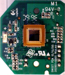 The web cam circuit board. The 'retina' is visible at the centre.