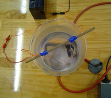 Close-up of the beaker and electrical connections.