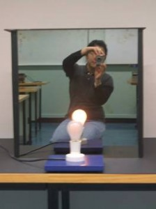A VUW student takes a video of the bulb that's off while its reflection is on!